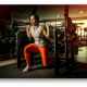 A girl in a commercial gym doing weight lifting - Verdure Wellness